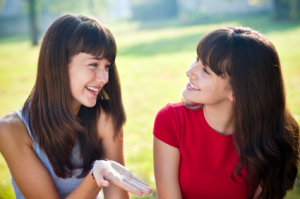 two beautiful teenage girls talking